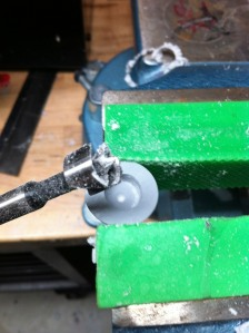 Reaver arm top being drilled with forstner bit
