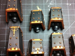 Reaver Titan piston guards with washed gold trim